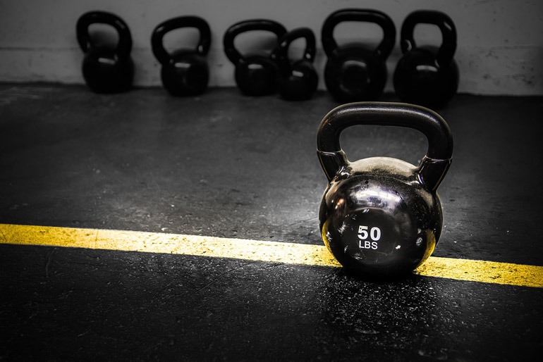 50 lb kettlebell on gym flooring