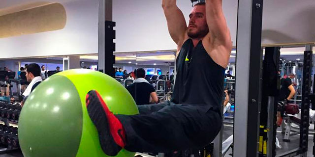 Hanging Leg Raises with Stability Ball