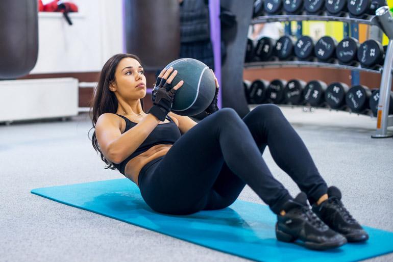 Medicine Ball Crunch on floor