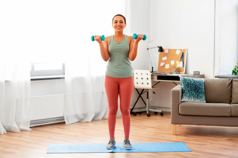 Woman is doing Bicep Curl at home