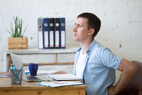 Back pain from sitting work without standing desks