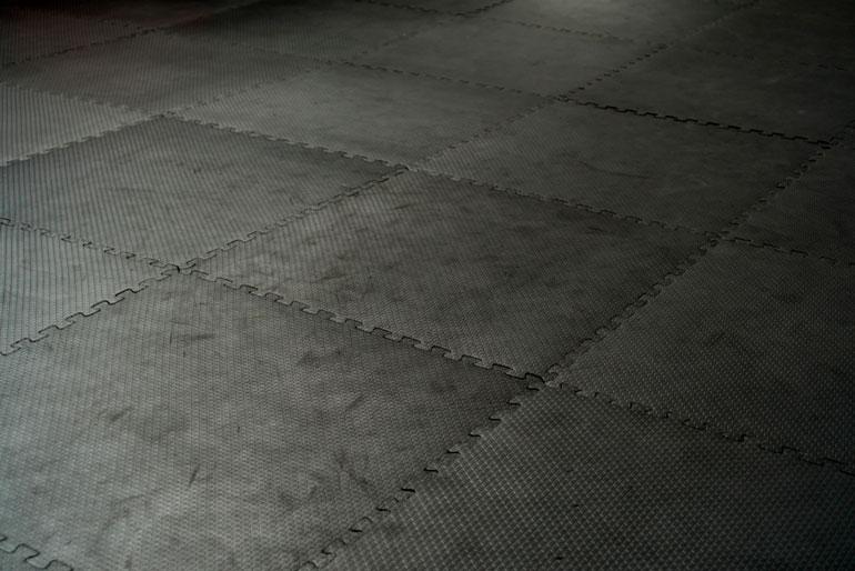 black flooring tiles at gym
