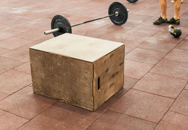 box and barbell on the floor