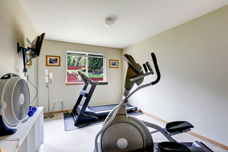 cardio home gym with TV and fan