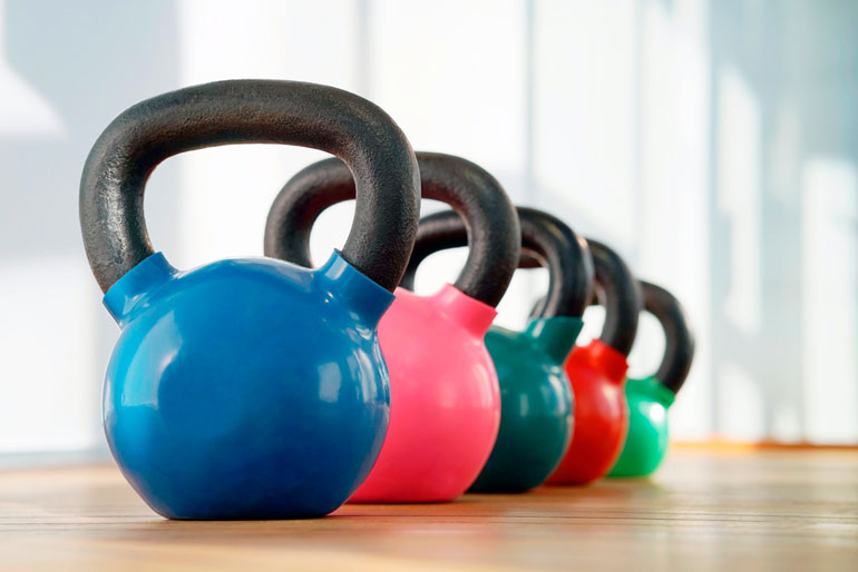 colorful kettlebells lined up