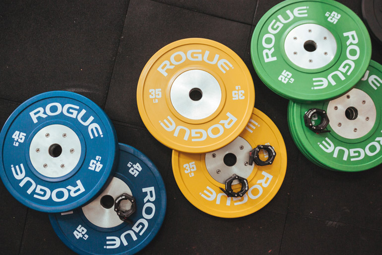 colorful rubber weight plates on floor