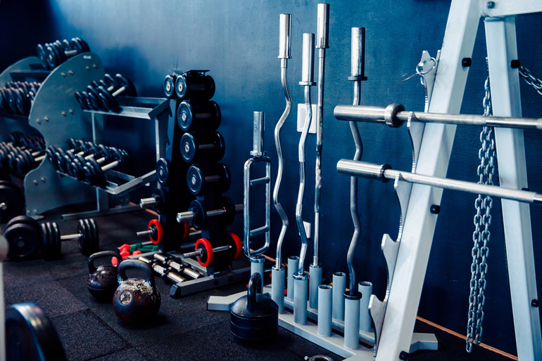 dumbbells and barbells are stored
