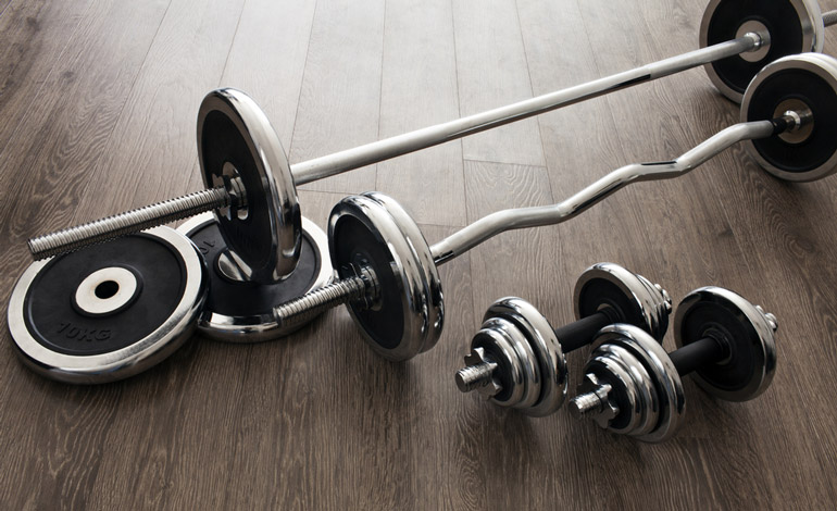 dumbbells and barbells on the floor