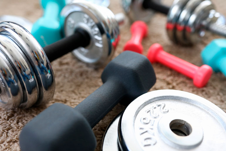 dumbbells are spread on the floor