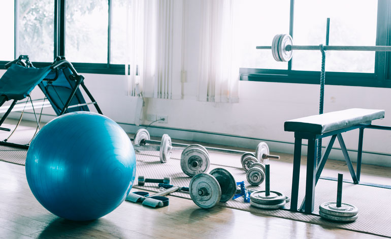 home gym equipment on wood floor