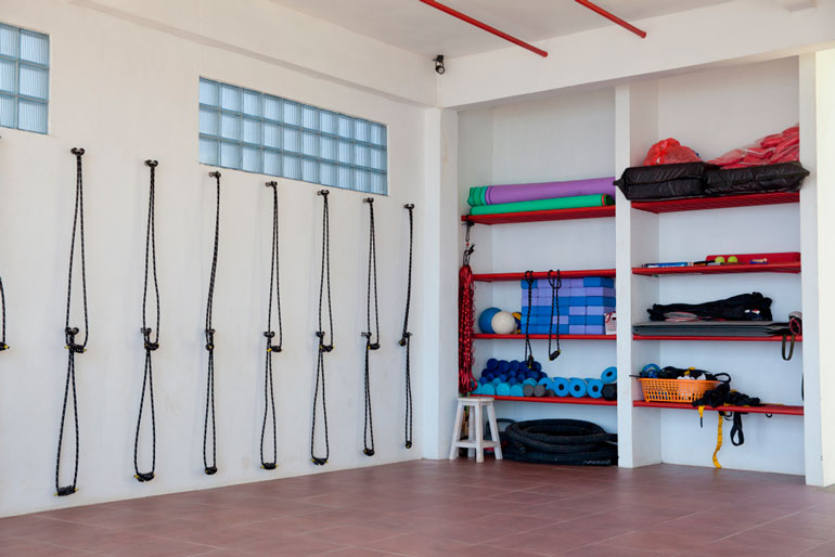 home gym with racks and loops
