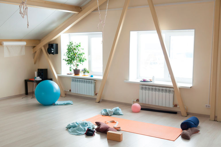 light room with home gym equipment