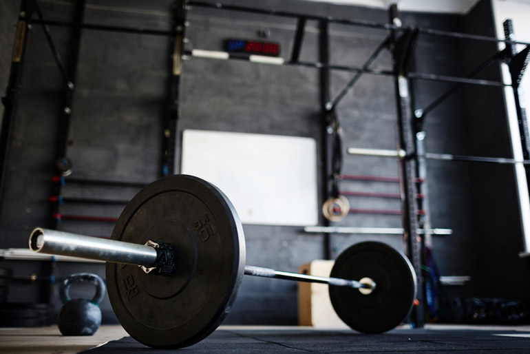 loaded barbell on gym floor