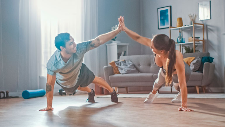 man and woman are exercising together