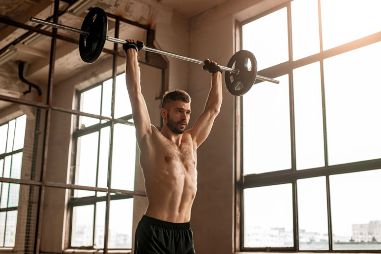 man doing the Overhead Press