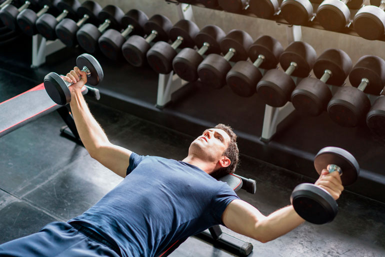 man is doing Chest Fly with dumbbells
