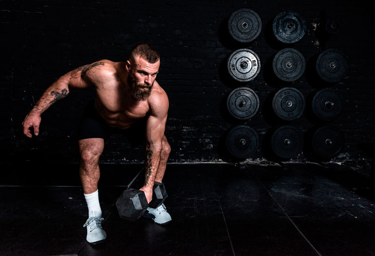 man is doing Dumbbell Snatch with dumbbell