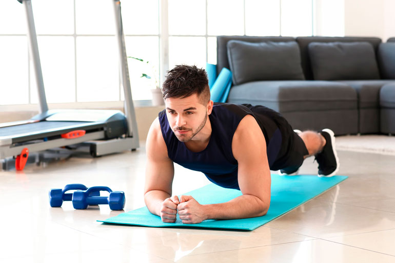 man is doing plank at home