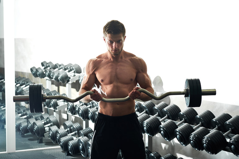 man is exercising with EZ bar