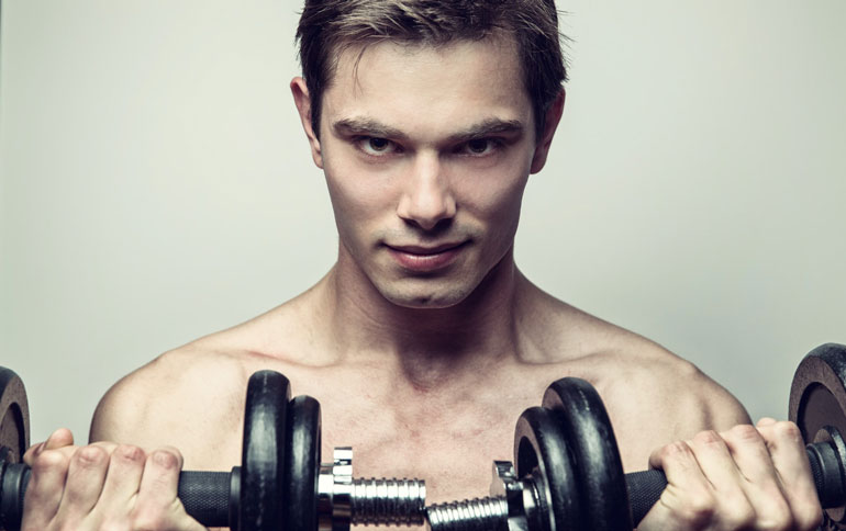 man is holding adjustable dumbbells to curl
