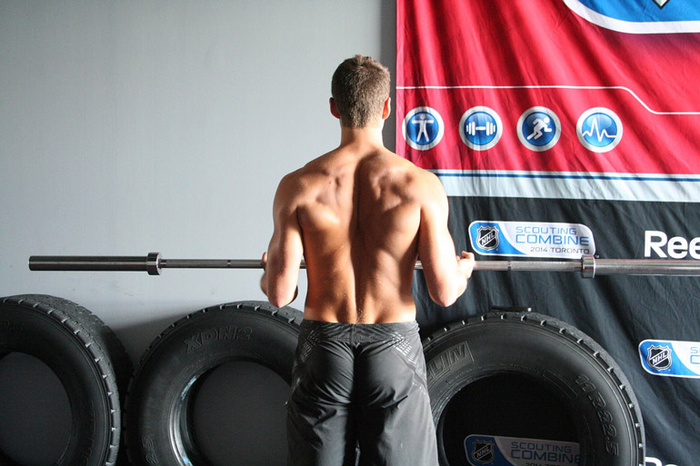 man is lifting barbell