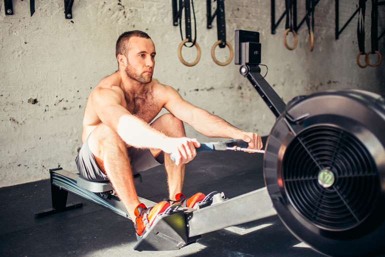 man is pulling bar on rower