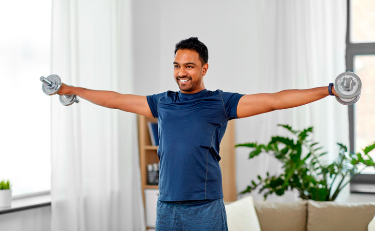 man is doing Lateral Raise at home