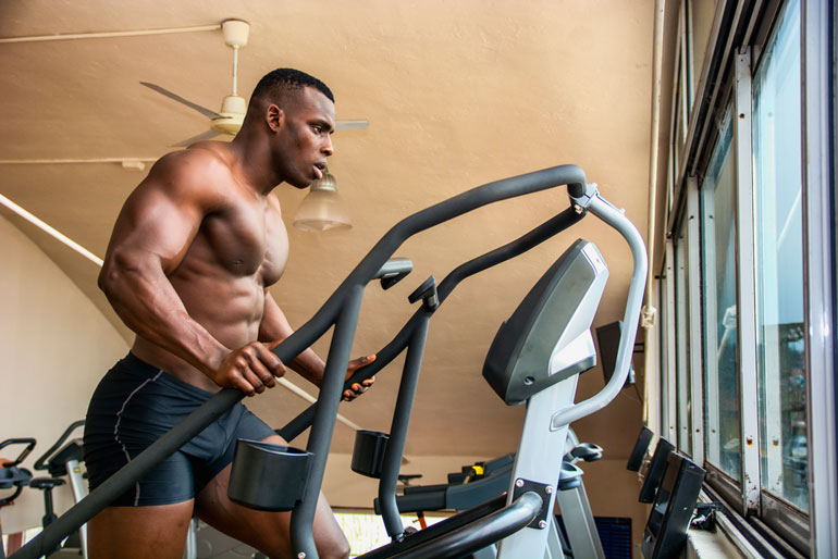 man is working out on stair machine