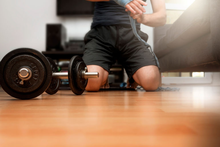 man is working out with adjustable dumbbells