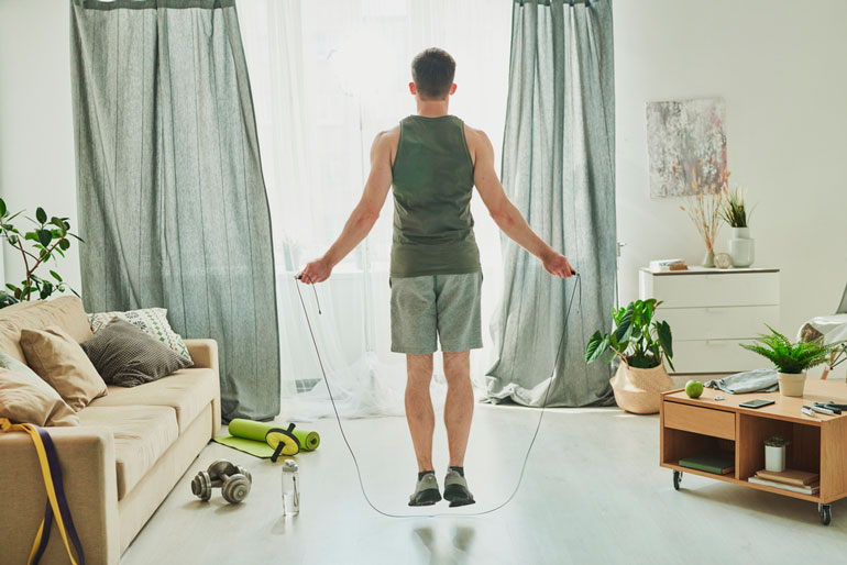 man is working out with jump rope