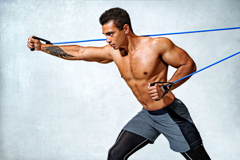 man is working out with resistance bands