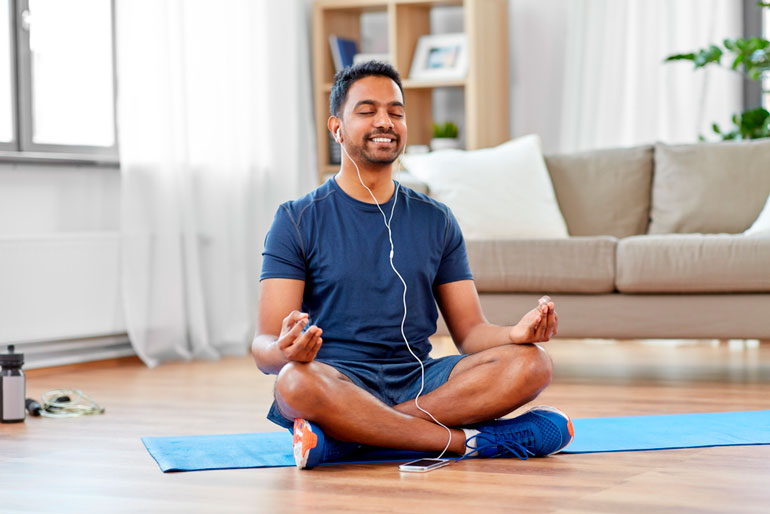 man is working out with yoga mat