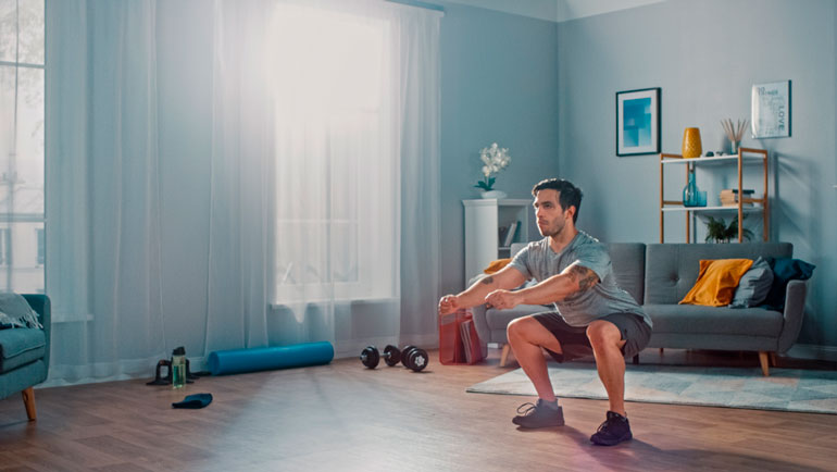 man performing Air Squat at home