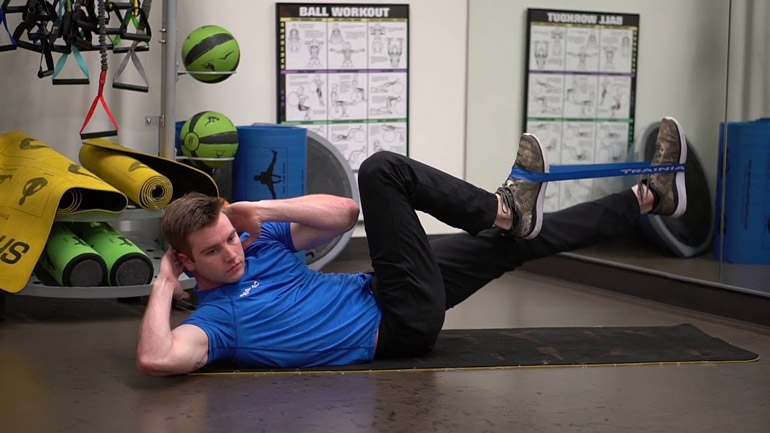 man performing Bicycle Crunch with a Resistance Band