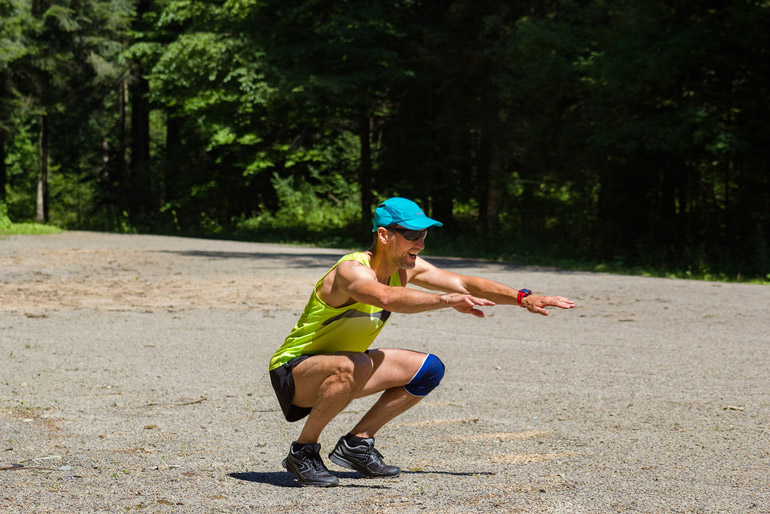man performing Jump Squats outdoors
