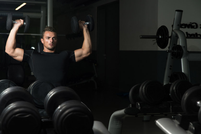 man performing Shoulder Press with dumbbells