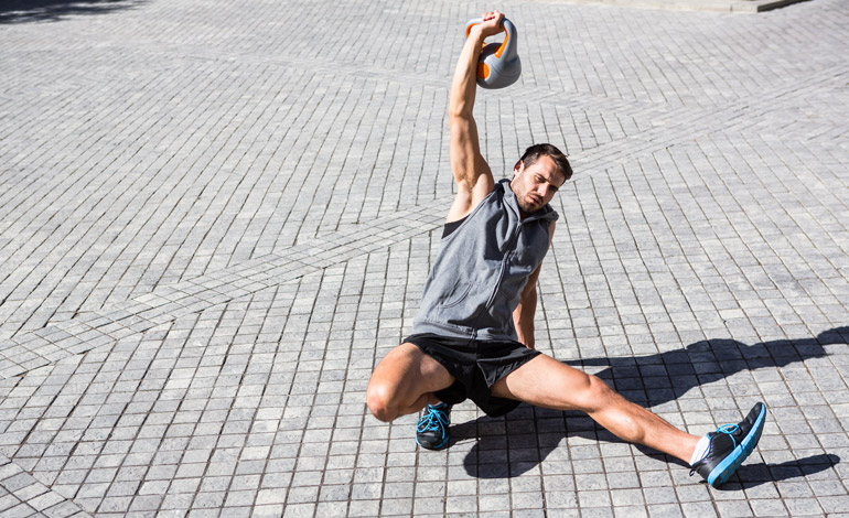 man performing kettlebell Turkish Get Up
