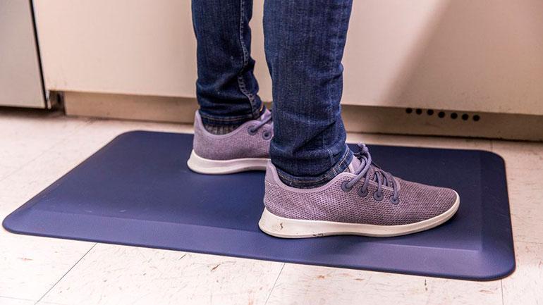 man standing on anti-fatigue mat