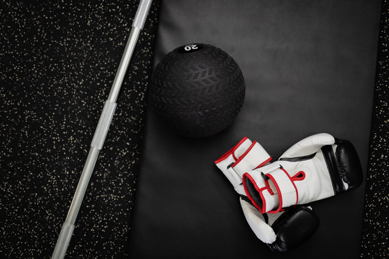 medicine ball with boxing gloves on gym floor