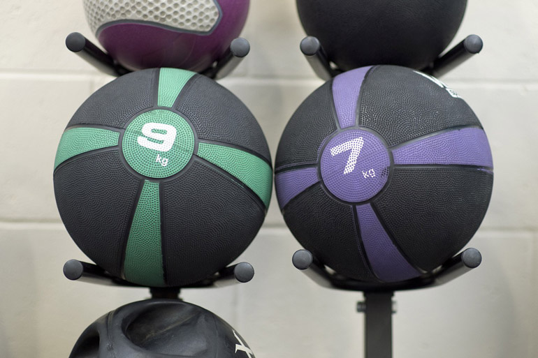 medicine balls on wall mount racks
