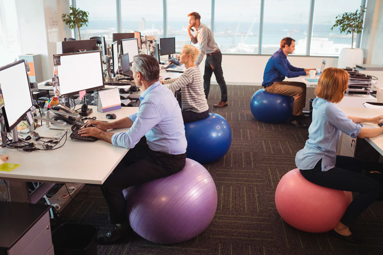 office workers are sitting on stability balls