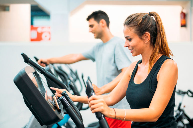 woman and man are setting step machines