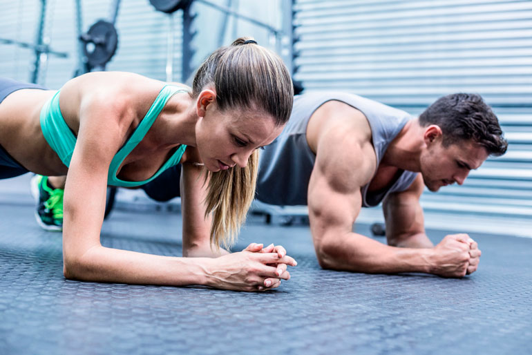 woman and man doing plank