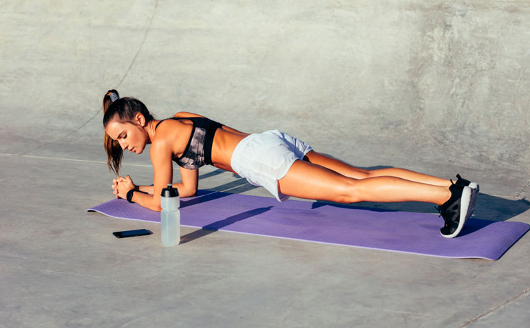 woman checking time when plank