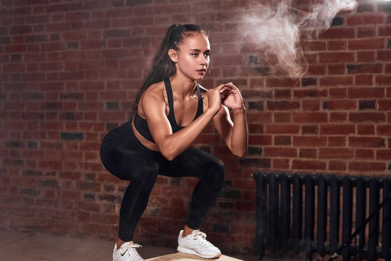 woman doing Jump Squats on box
