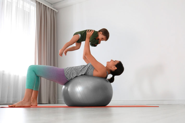 woman doing exercise with her son at home