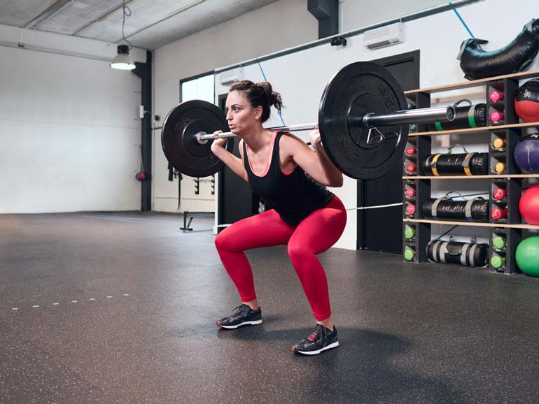 woman exercising in garage gym