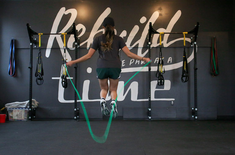 woman is Jumping with a Rope at gym