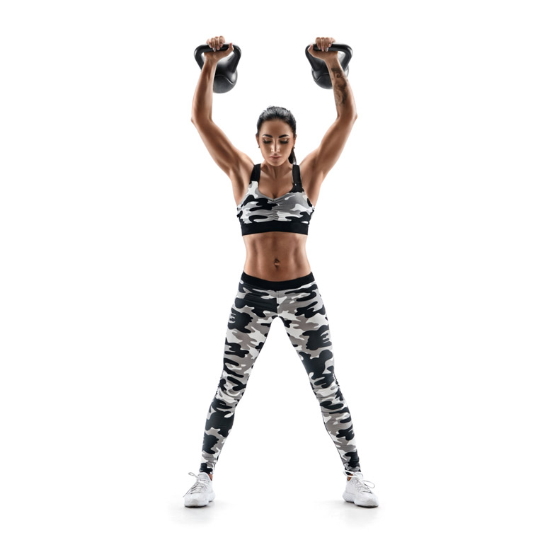 woman is doing Overhead Press with Kettlebells