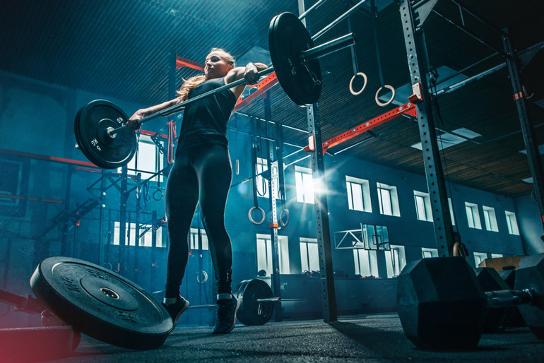 woman is dropping barbell